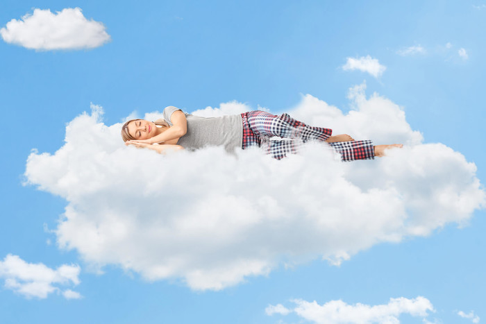 Woman sleeping on the cloud to boost productivity