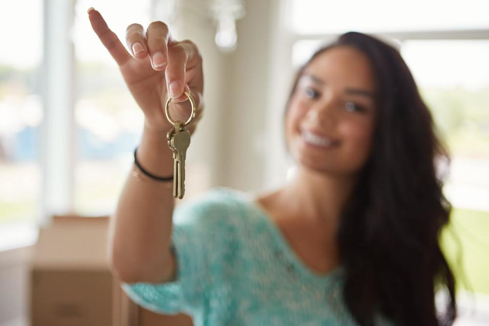 Turnkey rental property investment saleswoman