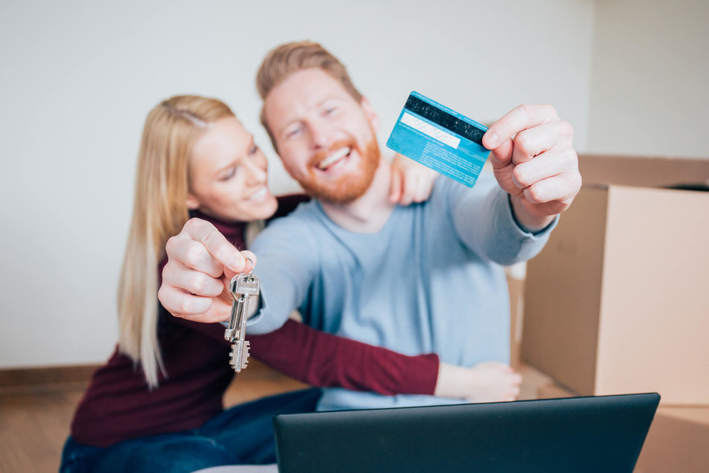 couple is paying their mortgage with credit card