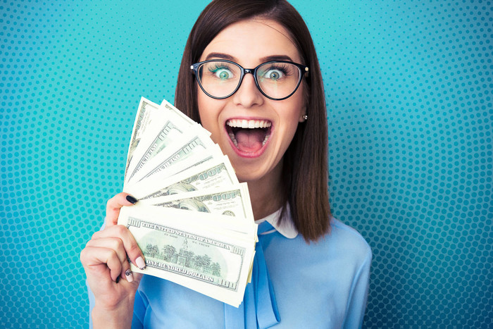 Young woman investing $1,000 dollars