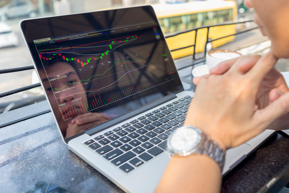 Man is buying options on the laptop