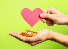 Giving hands with money symbolize that people contribute to the charity and get tax deduction