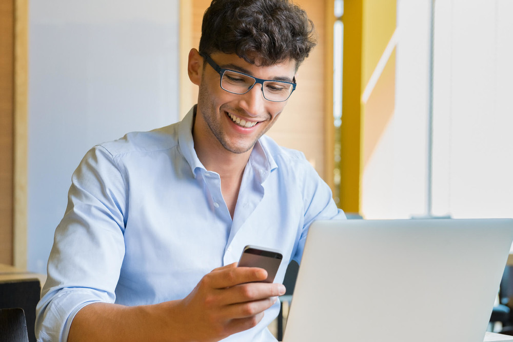 Young man investing from his phone