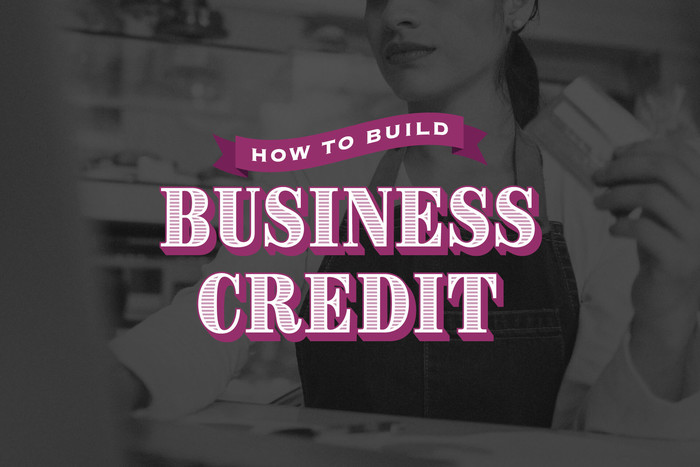 Woman building her business credit by paying with a credit card