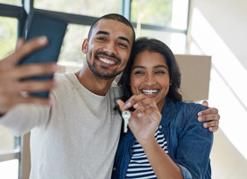 Couple of first time home buyers making a selfie