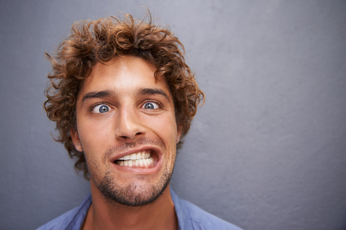 Guy smiling that doesn't need dental insurance