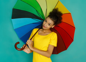 Personal insurance: woman with an umbrella symbolizes multiple aspects of insurance