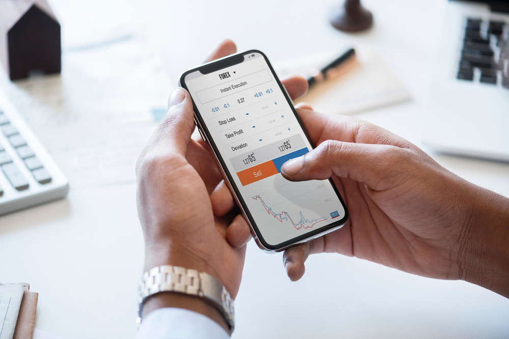 Man is buying stocks on the smartphone