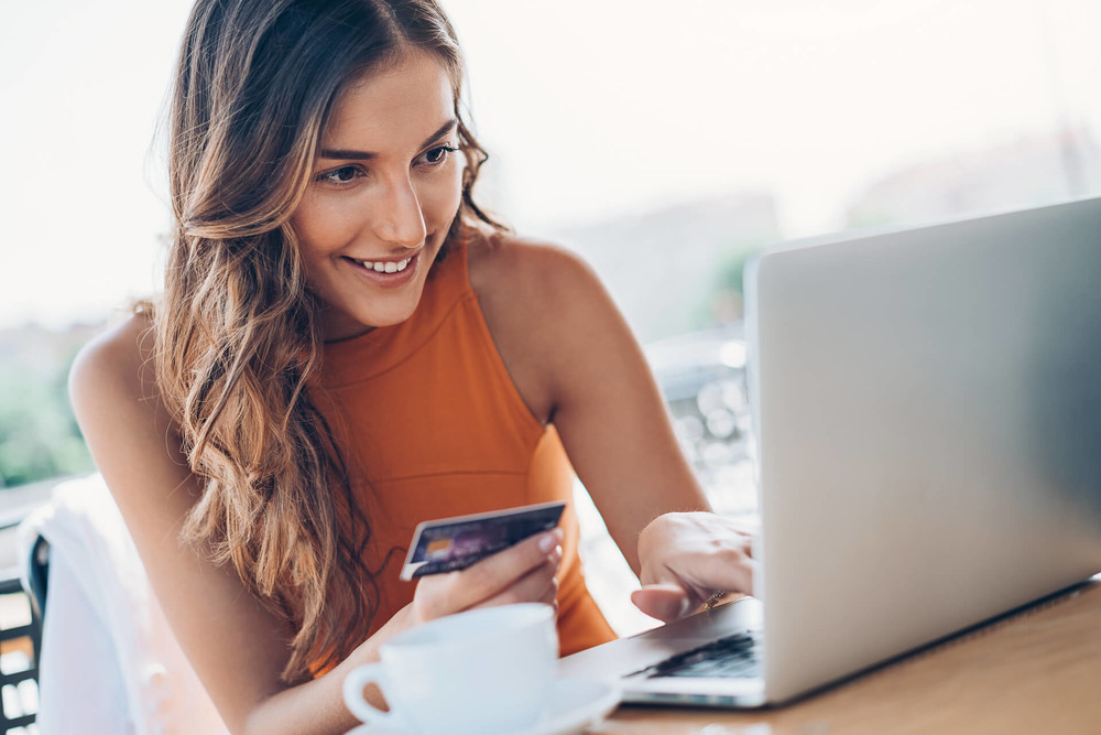 Young woman checking her credit balance