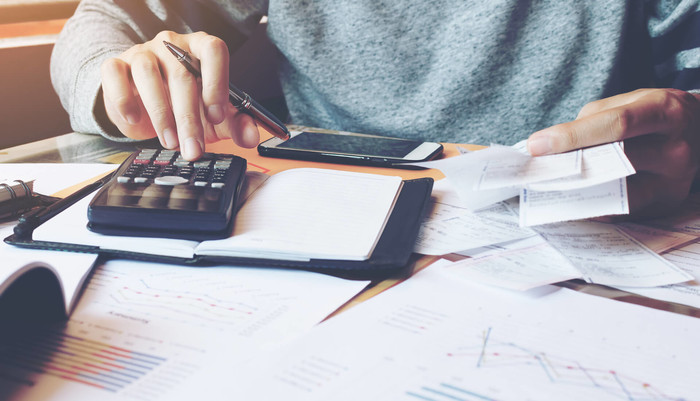 Man calculating tax advantages of being an entrepreneur