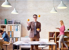 Man juggling oranges to demonstrate multitasking